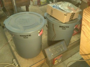 Two 20 Gal Garbage Cans with Something Valuable Inside