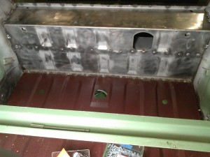 Front of Floor Pan Screwed to Axle Tunnel Lip
